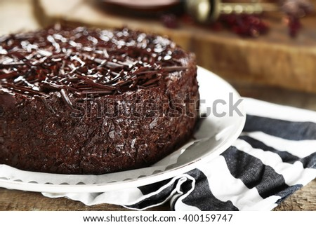 Tasty chocolate cake on wooden background