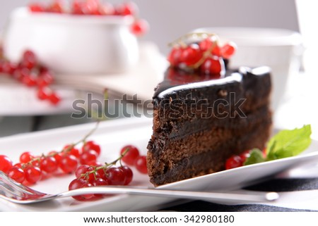 Tasty chocolate cake with berries on table close up - stock photo