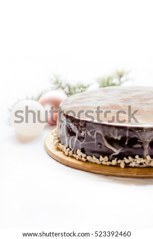 Tasty chocolate cake with nuts on white background. Soft focus