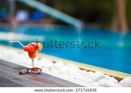 Tasty cocktail background swimming pool - stock photo