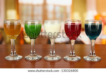 Tasty color liquors, on bright background