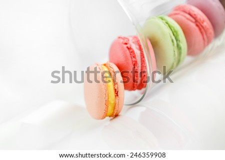 Tasty colorful macaroon. Colorful French Macarons on the white background. macaroons in glass - stock photo