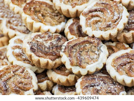 Tasty cookies with caramel cream filling and sugar sprinkles. Food theme. Refreshments for guests. International cuisine. - stock photo