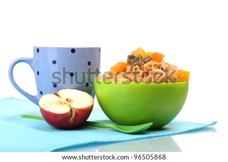 tasty cornflakes in green bowl, apple and glass of milk isolated on white - stock photo