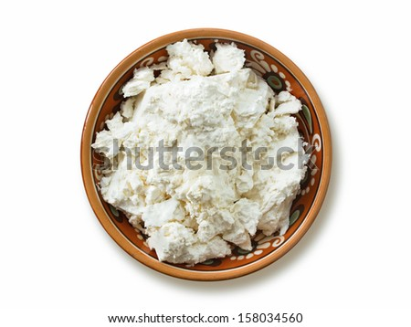 tasty cottage cheese in plate isolated on white background, top view  - stock photo