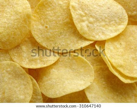 Tasty crackling snek. Potato chips, close-up - stock photo