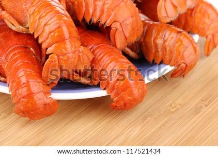 tasty crayfishes on plate isolated on white - stock photo