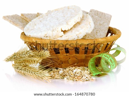 Tasty crispbread in basket, isolated on white