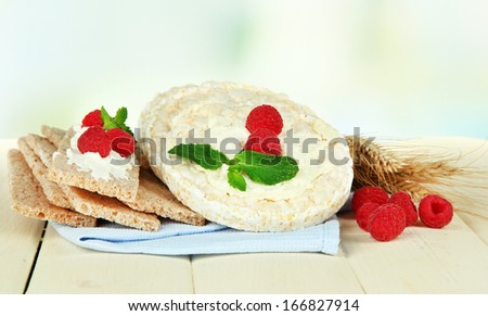 Tasty crispbread with berries, on white table
