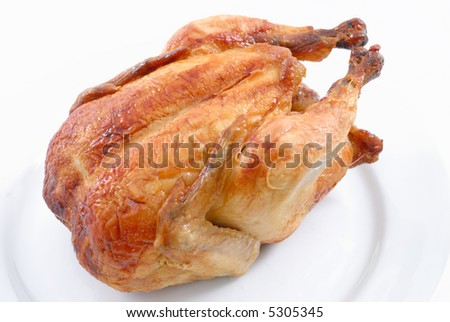 Tasty Crispy Roast Chicken on white plate .