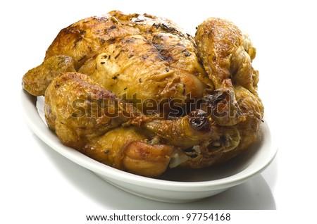 Tasty Crispy Roast Chicken on white plate - stock photo