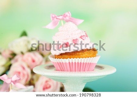 Tasty cup cake with cream, close up