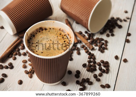 tasty cup of cappuccino on white wooden table - stock photo