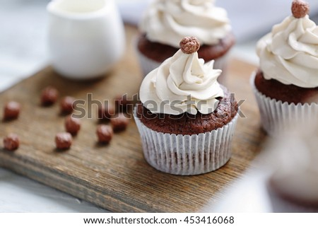 Tasty cupcake on cutting board, closeup