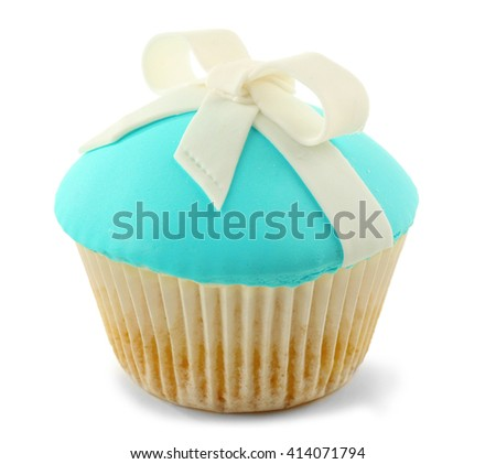 Tasty cupcake with bow, isolated on white