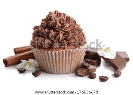 Tasty cupcake with butter cream, isolated on white - stock photo