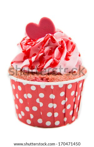 Tasty cupcake with butter cream on white background - stock photo