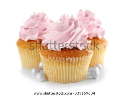 Tasty cupcakes, isolated on white - stock photo