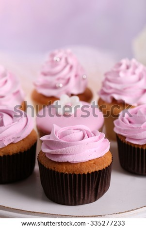 Tasty cupcakes on stand, close-up