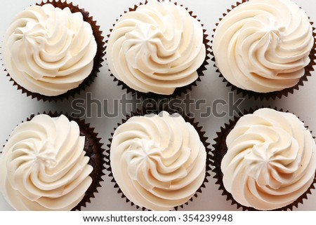 Tasty cupcakes on white background, close up - stock photo