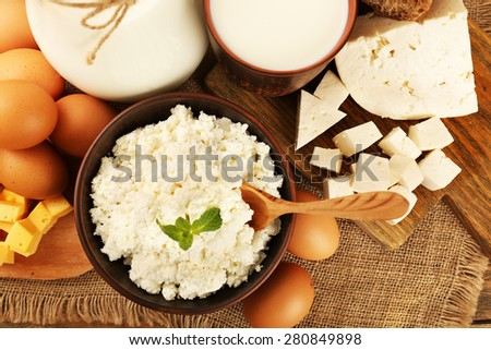 Tasty dairy products on sackcloth background - stock photo