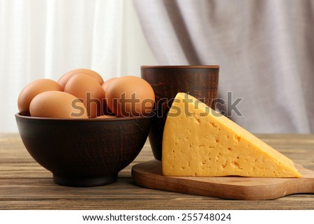 Tasty dairy products on table on fabric background - stock photo