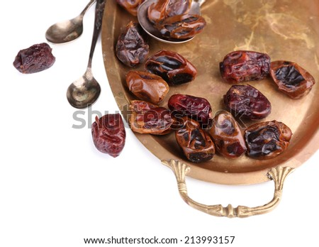 Tasty dates fruits on old metal tray, isolated on white