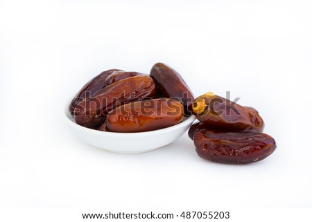 Tasty dates isolated on white background.