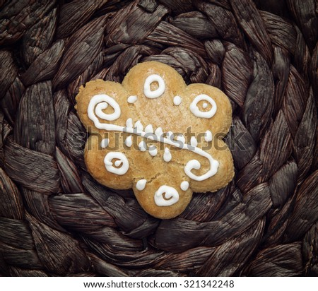 Tasty decorated gingerbread cookie on the dark background. Christmas holidays. Yuletide. - stock photo