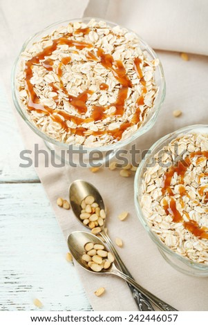 Tasty dessert with oat flakes, on table