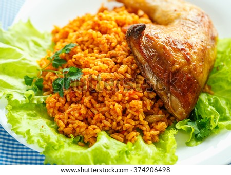 Tasty dish of chicken thigh with rice and salad leaves
