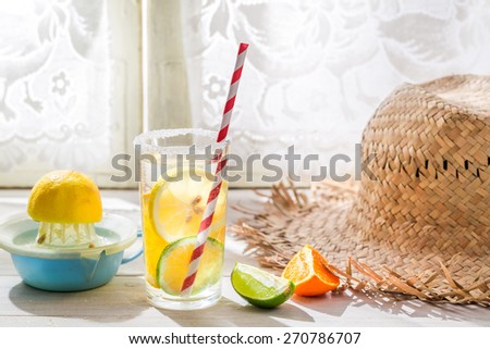 Tasty drink with straw and fruits