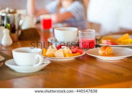 Tasty exotic breakfast at outdoor restaraunt - stock photo