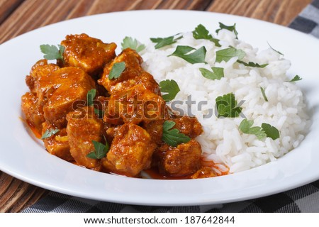 tasty fillet chicken curry with rice on a plate on the table closeup horizontal  - stock photo