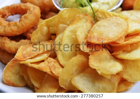 tasty fish sticks and potatoes deep fried