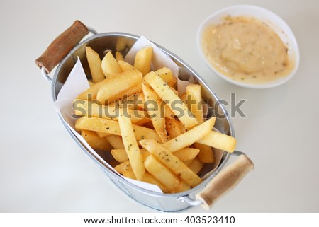 Tasty french fries on table background - stock photo