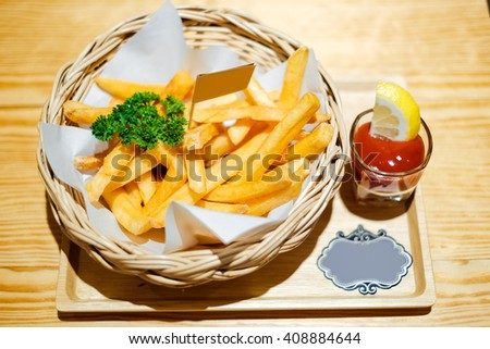 Tasty french fries with ketchup - stock photo