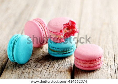 Tasty french macarons on a grey wooden table - stock photo
