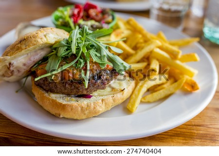 tasty fresh hamburger with salade and french fries - stock photo