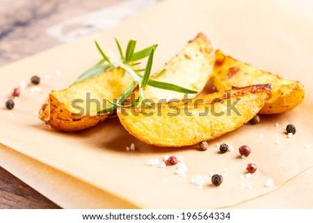 tasty fried potato slices with herbs. - stock photo