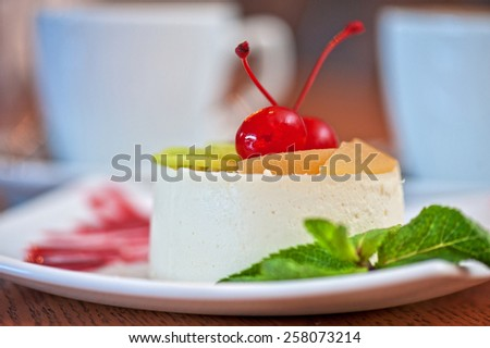tasty fruit dessert with cherry and kiwi with coffee - stock photo