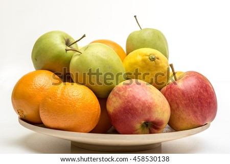 Tasty fruit orange, apples and banana on the wooden plate