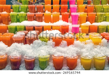 Tasty fruit smoothies at the Boqueria market in Barcelona - stock photo