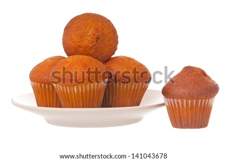 Tasty fruitcakes on a saucer isolated on a white background - stock photo