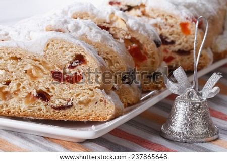 Tasty German Christmas fruit cake Stollen closeup on a white plate. horizontal  - stock photo