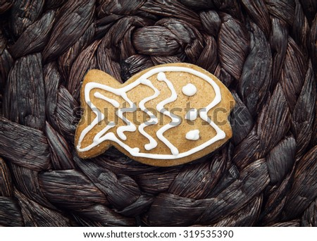 Tasty gingerbread fish on the dark background. Christmas theme. - stock photo