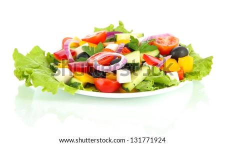 Tasty Greek salad isolated on white - stock photo