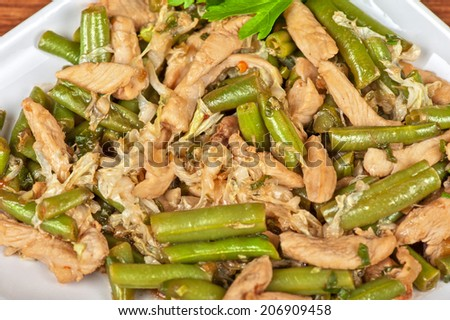 Tasty green beans with chicken meat