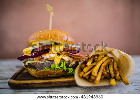 Tasty grilled beef and prawn burger with lettuce and mayonnaise