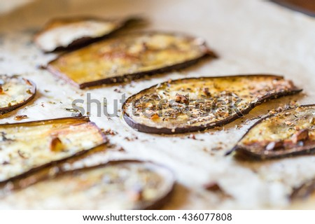 Tasty Grilled Eggplants with Garlic, Parsley and Olive Oil on a Grilling Pan, Close-up View - stock photo